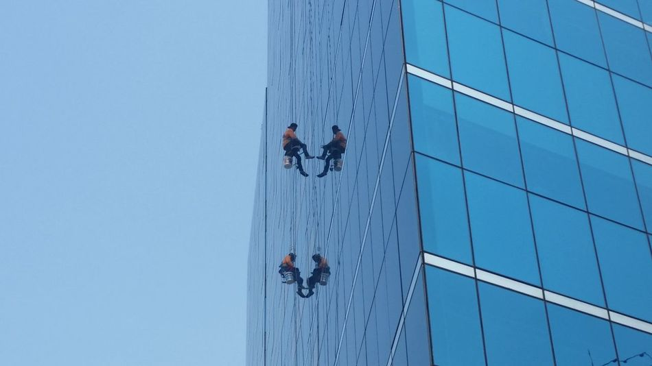 work at height Dangerous Safety First Safety Hazardous Workers Labor Laborday Mirror Reflections Glass Glass Material Hanging Falling Rope Symetry Reflection The Architect - 2016 EyeEm Awards The Street Photographer - 2017 EyeEm Awards