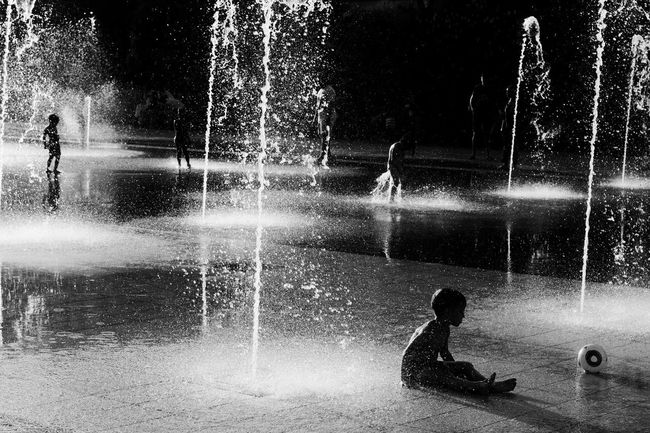 Water Boys Childhood Child One Person People Children Only Spraying One Boy Only Outdoors EyeEmNewHere The Week On EyeEm Playground Playing Boy Nice, France Nice / Nizza Black And White Photography Bw_lover Streetphotography_bw Monochrome Street Life Real People City Street Art