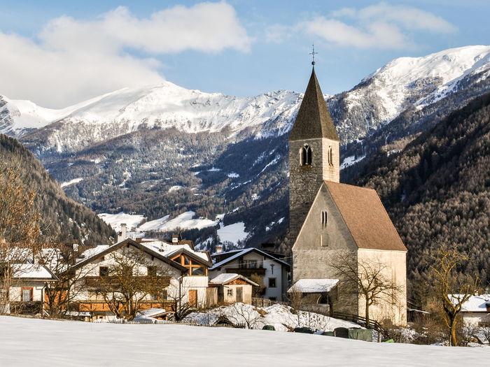 Church against snowcapped mountain