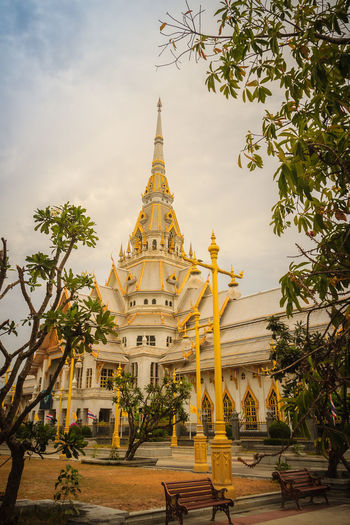 Beautiful golden pagoda at Wat Sothonwararam, a famous public temple in Chachoengsao Province, Thailand. Buddhist Temple In Thailand Buddhist Temple, Buddhist Temples Chachoengsao Chachoengsao Province WAT Sothon Wara RAM Worawihan (WAT Luang PHO Sothon) Wat Sothon Wat Sothon Wararam Worawihan Architecture Belief Buddhist Temple Building Building Exterior Built Structure Cloud - Sky Day Golden Pagoda Golden Pagodas Nature No People Outdoors Place Of Worship Plant Public Temple Religion Sky Sothon Spire  Spirituality Tower Travel Destinations Tree Wat Sothonwararam