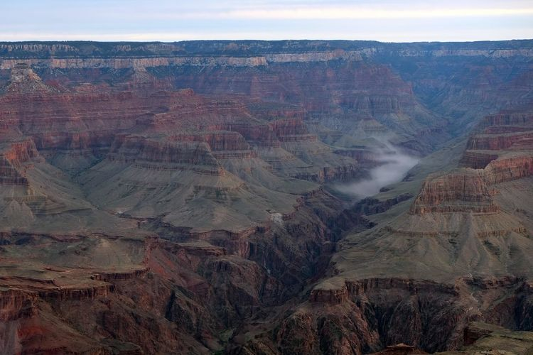 View from the South Rim of the Grand Canyon, Arizona, with fog over the Colorado River Arizona Grand Canyon Beauty In Nature Colorado River Dawn Day Fog Fog Over River Geology Landscape Nature No People Outdoors Physical Geography Rock - Object Rock Formation Scenics Sky South Rim Sunrise Tranquil Scene Tranquility Travel Destinations