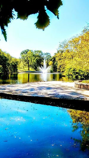 Water Beauty In Nature Tree Nature Blue Scenics No People Sky Lake Day Outdoors Spraying Freshness Park Life Fountain_collection lake view Early Fall Garden Architecture EyeEm Gallery Irwin Collection