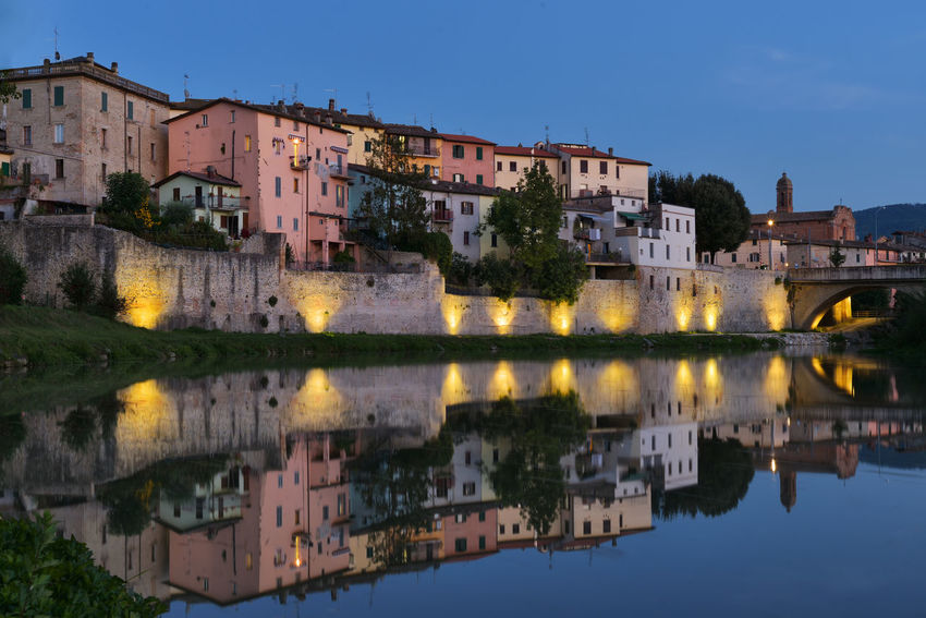 Umbertide, Italy, view and reflections in Tevere river at blue hour. Architecture Blue Building Building Exterior Built Structure Calm Canal City City Life Clear Sky Day In Front Of No People Reflection Residential Building Residential District Residential Structure River Sky Standing Water Town Umbertide Malephotographerofthemonth