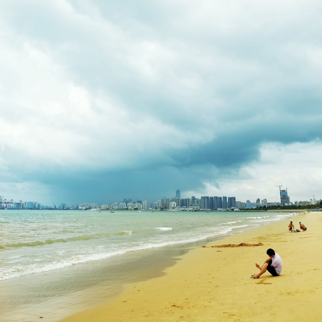 beach, land, water, sea, sky, cloud - sky, sand, one person, beauty in nature, nature, real people, day, leisure activity, scenics - nature, architecture, relaxation, built structure, men, outdoors