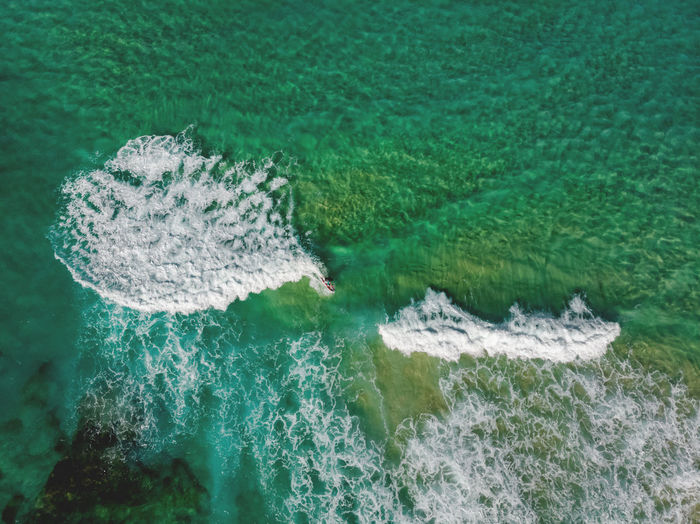 High angle view of water flowing in sea