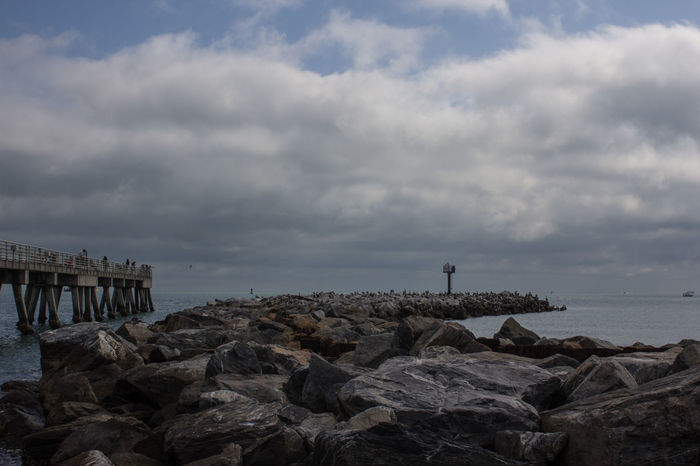 Jetty & pier Fishing Pier Inlet Jetty Park No People Pier Port Canaveral Rock Formation Rock Jetty Storm Clouds Stormy Skies