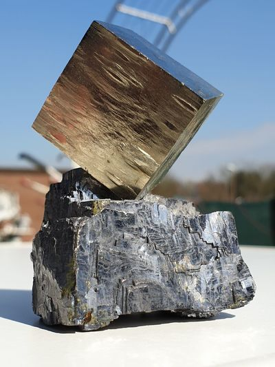 Close-up of rock on table against sky