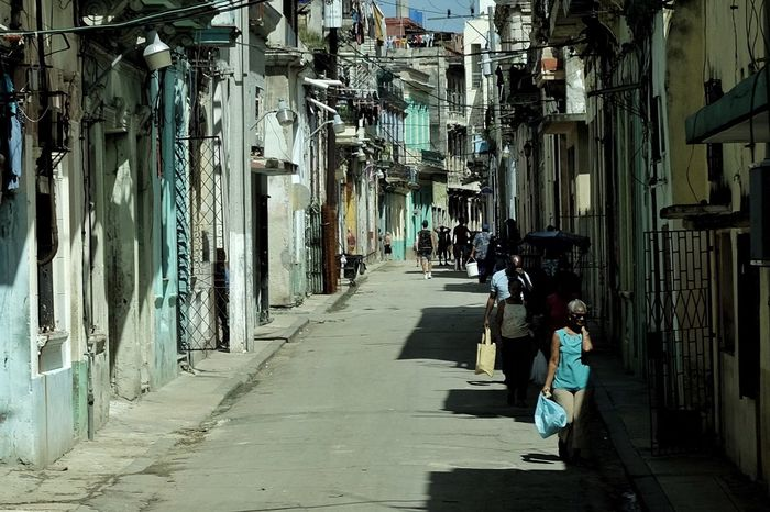 Those living in some neighborhoods of Havana walk in the streets rather than sidewalks for fear of being struck by crumbling building facades. Cuba Collection Cuba Havana Real People Architecture Full Length Built Structure Women Building Exterior Two People The Way Forward Walking Day Adults Only