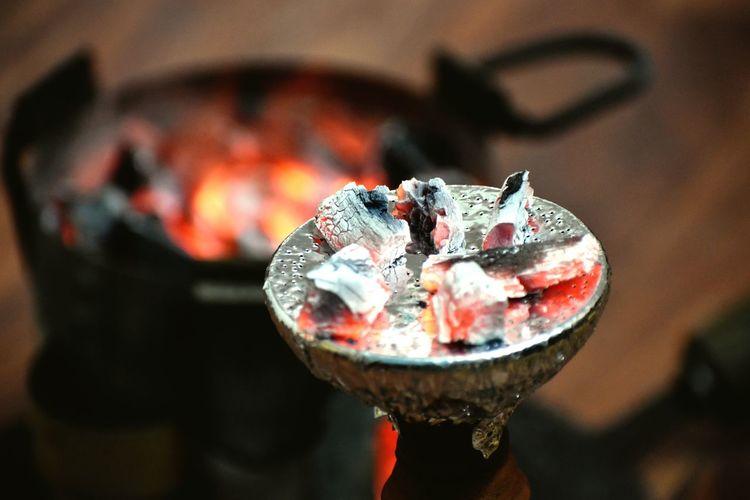 Close-Up Of Burning Coals On Hookah