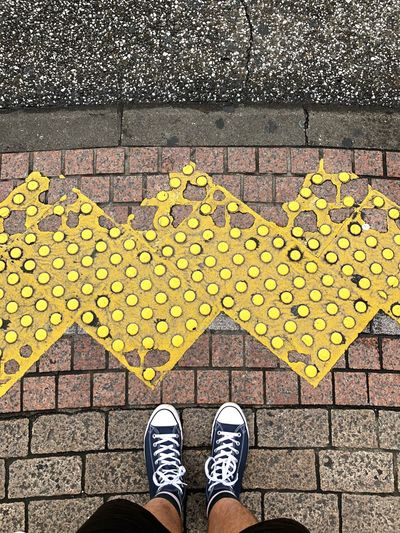 View when I look down while waiting at Shibuya Crossing Low Section Shoe Human Leg Standing Body Part One Person Human Body Part Personal Perspective Pattern Yellow High Angle View