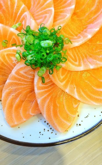 Close-up of orange slices in plate on table