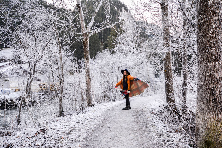 Full Length Of Woman In Winter Forest