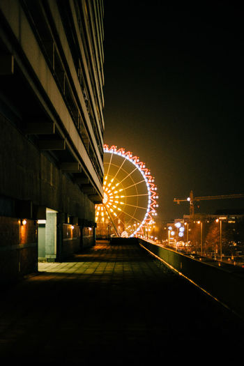 Night Illuminated Architecture Built Structure Amusement Park Ride Ferris Wheel Building Exterior Amusement Park Arts Culture And Entertainment No People Transportation City Motion Sky Nature Outdoors Lighting Equipment Street Copy Space Street Light
