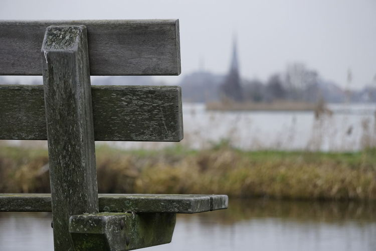 Seat with a view Water Focus On Foreground Built Structure Nature Day No People Architecture Wood - Material Plant Outdoors Tree Close-up Tranquility View Groene Hart Bench Village Rural Scene