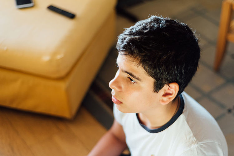 High angle view of boy looking at home