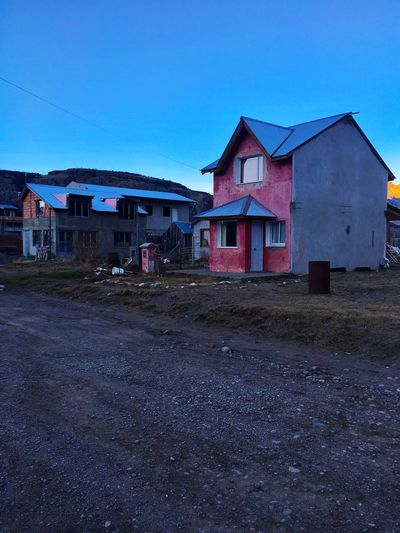 Building Exterior Built Structure Architecture House Clear Sky Blue Residential Structure Street Road Residential Building Cable Town Outdoors Day Surface Level No People Residential District Power Line  Colorful Empty Road Patagonia Argentina El Calafate Fresh On Eyeem