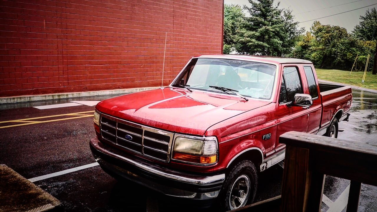 red, transportation, land vehicle, car, outdoors, mode of transport, day, no people