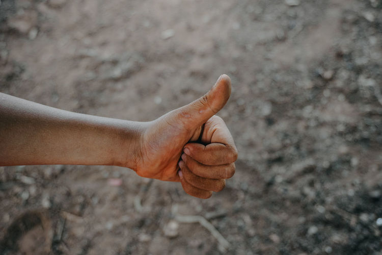 Close-up of man hand gesturing outdoors