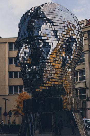 Prague. More: https://barbara-duchalska.blogspo Franz Kafka Prague Apartment Architecture Building Building Exterior Built Structure City Communication Day Incidental People Kafka Lifestyles Men Nature Outdoors Real People Reflection Residential District Sky Sunlight Tree Window