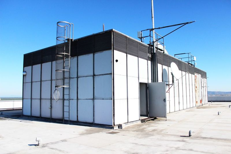 Industrial Photography Industrial Rooftop EyeEm Selects Built Structure Architecture Building Exterior Clear Sky Day Outdoors Sunlight Sky Warehouse No People