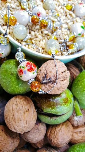 jewellery walnuts and bowl with wheat Harvesting Concept Agriculture Fruits Walnut Husk Wheat Cereal Green Color Grain Fashion Necklace Jewellery Nuts Autumn colors Fall Beads Ceramic Fashion Photography Variation Close-up Food And Drink Nutshell Nut