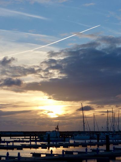 Sky Cloud - Sky Sunset Water Transportation Mode Of Transportation Vapor Trail Beauty In Nature Sea Nature Tranquil Scene Silhouette Scenics - Nature Nautical Vessel Outdoors Tranquility No People Architecture Harbor Sailboat EyeEmNewHere EyeEmNewHere