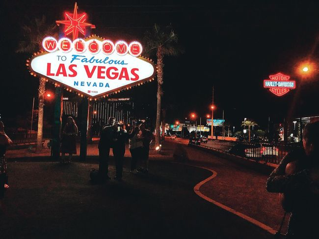 Las Vegas Illuminated Night Text Western Script Communication City Sign Street Building Exterior Built Structure Road Architecture No People Information Capital Letter Lighting Equipment Outdoors Guidance Road Sign Nature