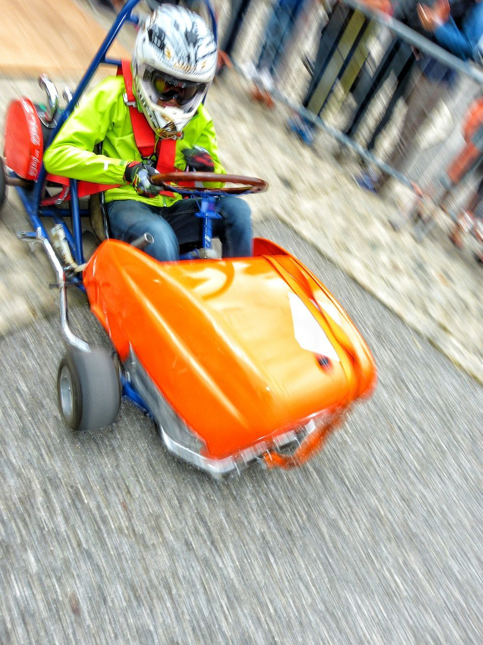 blurred motion, speed, sports race, motion, outdoors, day, motorsport, one person, competition, auto racing, racecar, people