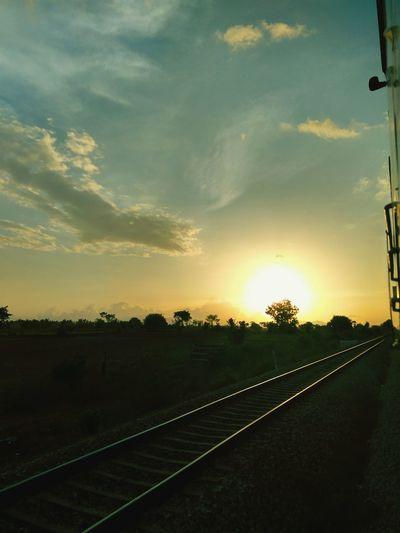Traveling Train Train Tracks Shining In Sunlight. Faraway Sunset Sunset Karnataka India
