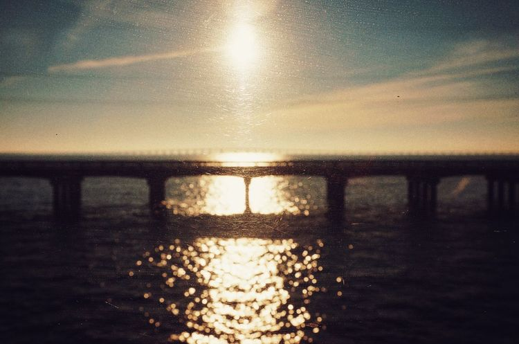 Glistening Missisippi River NOLA Neworleans USA Travel Amtrak Sunset Wanderlust Bridge Reflection