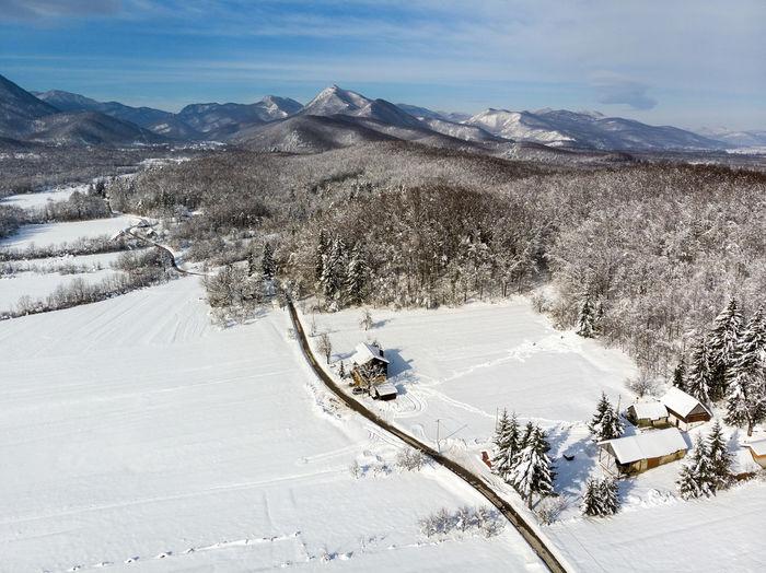 Winter in wooden village in lika, croatia
