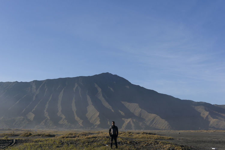 Full length of man standing on land against sky mount bromo