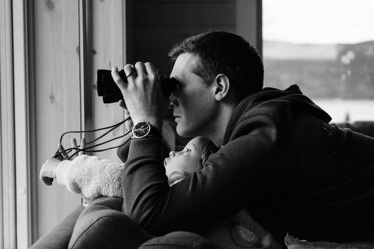 Man holding camera at home