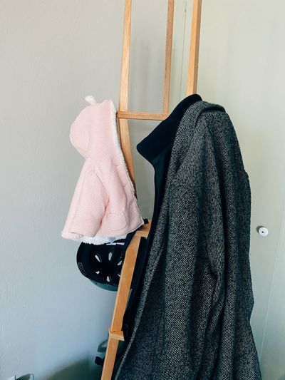 Clothes drying on clothesline against wall at home