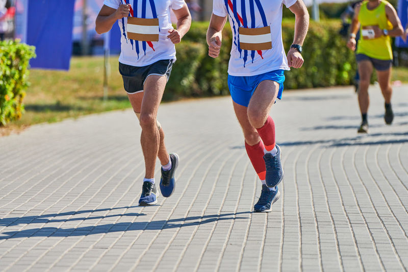 Low section of people running