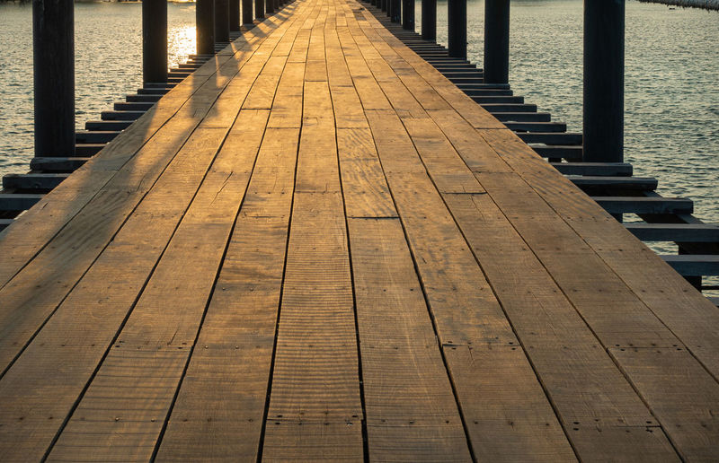 Surface level of wooden pier over sea