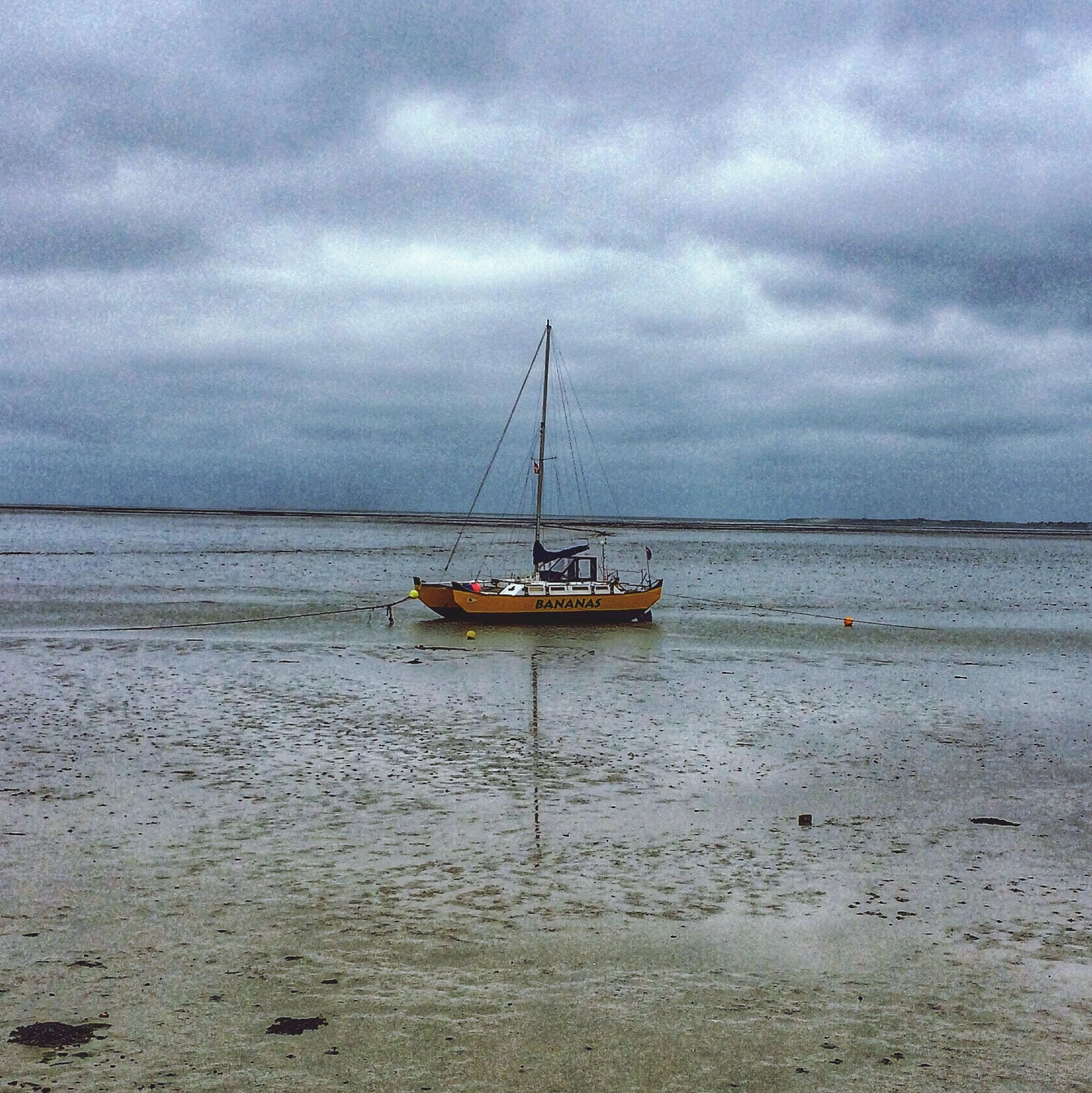 nautical vessel, water, sea, transportation, sky, boat, mode of transport, cloud - sky, horizon over water, cloudy, tranquility, beach, tranquil scene, moored, scenics, nature, beauty in nature, shore, cloud, weather