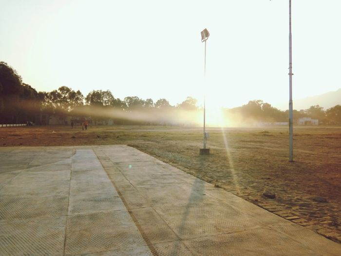 Morning time Light Falling Beaming On The Ground On The Playing Ground Dust In The Air Football Ground