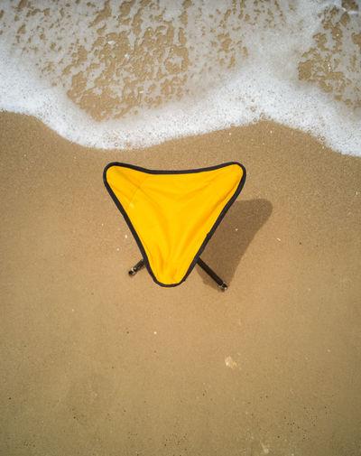 High angle view of stool on beach