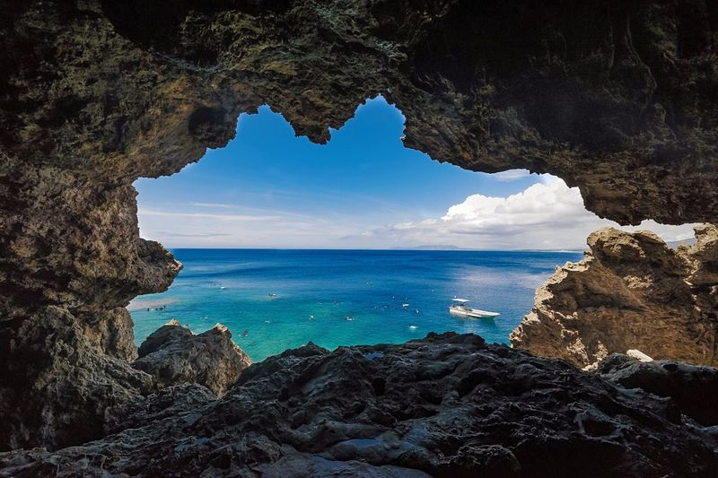 Scenic view of sea seen through rock hole