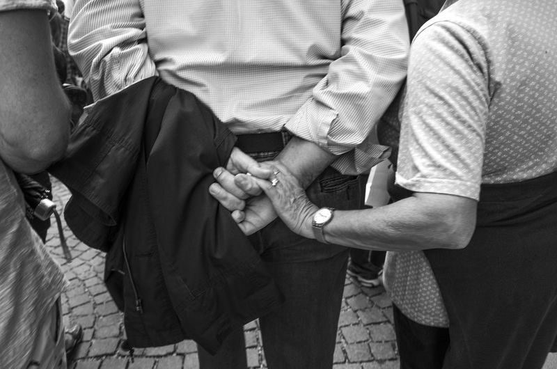 it's the little things Bonding City Life Connection Couple Crowd Crowded Everybodystreet Everyday Lives Holding Holding Hands Love Love Monochrome Photography Streetphotography Together Togetherness Touching Trust TCPM