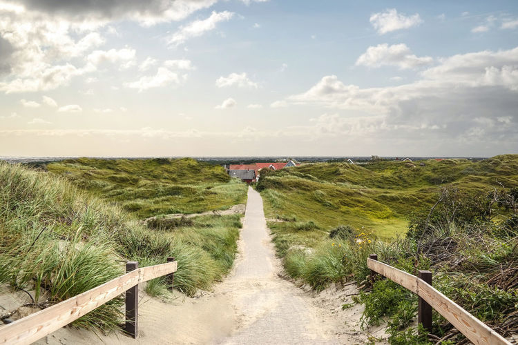 Beach Beautiful Beauty In Nature Blue Sky Coast Day Dunes Footpath Grass Landscape Marram Grass Nature No People Outdoors Path Peaceful Relax Rural Scene S Scenery Seascape Sky Sunlight Tranquility View