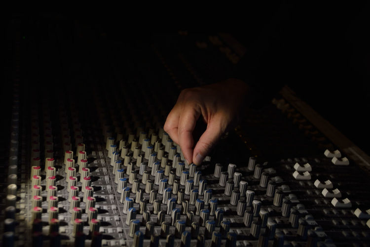 Close-up of man controlling sound mixer