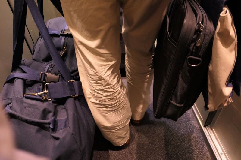 Low Section Of Man With Luggage In Train