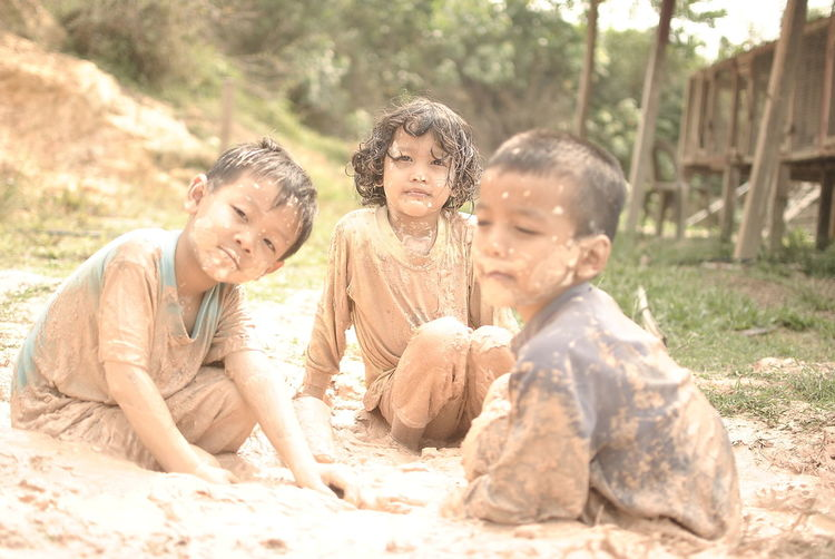 Friends Playing In Mud