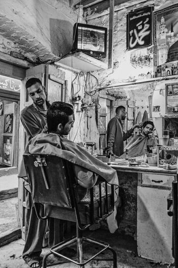 A barber shop in Saidpur village, Islamabad. Barbershop Life In Motion People Streetphotography Street Photography Blackandwhite Black And White Monochrome EyeEm Gallery Taking Photos