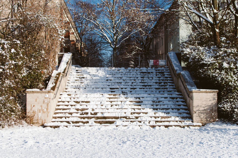Front View Of Snow Covered Stairs In City