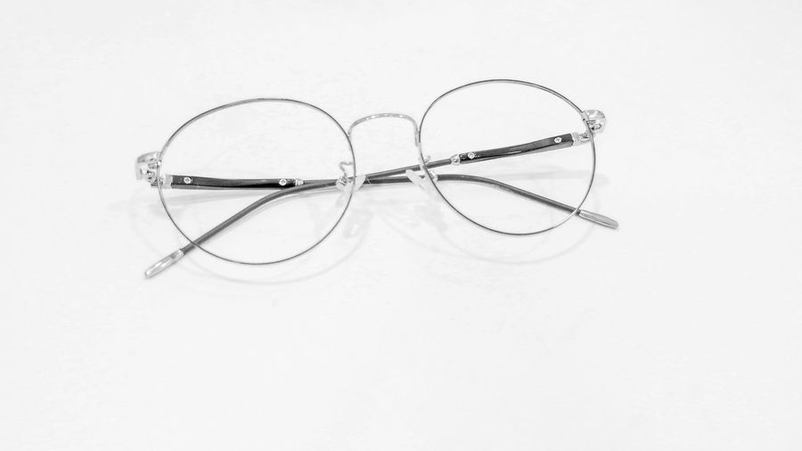 High angle view of eyeglasses on white background