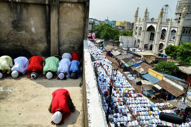 High angle view of people praying on road in city