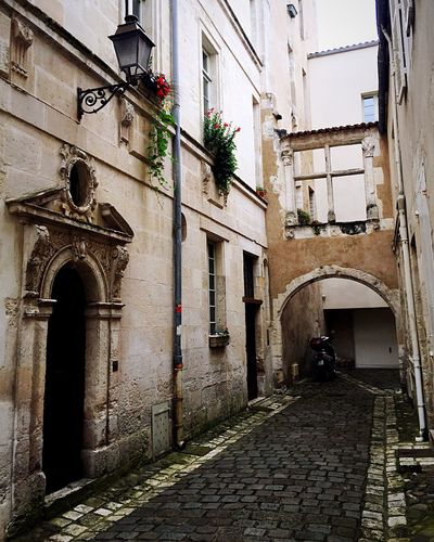 ... otherwise a charming city... Architectural Detail Architecture Door Lamp Design Outdoors Outdoor Photography Exterior House Old Buildings Old Old House Cityscapes Streetphotography France Street Photography Traveling Old Building  Exterior Design Alley Vacation Beautiful Cozy Street Doors